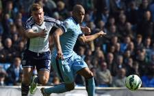 West Bromwich Albion's English-born Scottish midfielder James Morrison (L) competes with Manchester City's Brazilian midfielder Fernando during the English Premier League football match between Manchester City and West Bromwich Albion at the Etihad Stadium in Manchester, north west England, on March 21, 2015. Picture: AFP
