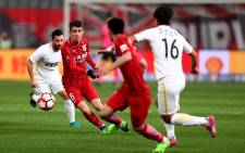 Shanghai SIPG's Brazilian midfielder Oscar (2nd L) during a Chinese Super League match against Changchun Yatai. Picture: AFP