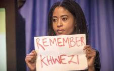 One of the four demonstrators who staged a silent anti-rape protest during President Jacob Zuma's address at the IEC briefing on 6 August 2016. Picture: Thomas Holder/EWN.