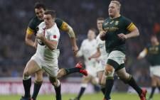 FILE: England's fly half George Ford (C) runs through the South African defence on his way to score a try during the rugby union test match between England and South Africa at Twickenham in southwest London on 12 November 2016. Picture: AFP