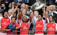 Mikel Arteta lifts the Community Shield with (L-R) Olivier Giroud, Alexis Sanchez, Alex Oxlade-Chamberlain and Tomas Rosicky after beating Manchester City on 10 August 2014. Picture: Arsenal FC Official Facebook page.