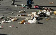 Striking municipal workers dump rubbish out of bins as they protest. Picture: Danya Philander/Eyewitness News
