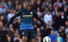 Manchester City's Ivorian midfielder Yaya Toure (L) vies with Aston Villa's Austrian striker Andreas Weimann (R). Picture: AFP