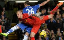 Chelsea's English defender John Terry (L) jumps for the ball against Liverpool's Slovakian defender Martin Skrtel (R) during the English Premier League football match at Stamford Bridge in London on 29 December, 2013.