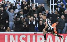 Newcastle United's Scottish midfielder Matt Ritchie celebrates after scoring the opening goal during the English Premier League football match between Newcastle United and Manchester United at St James' Park in Newcastle-upon-Tyne, north east England on 11 February 2018. Picture: AFP.