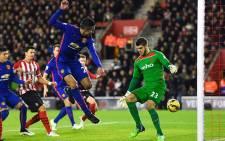 FILE: Manchester United striker Robin van Persie slides one past Southampton keeper Fraser Forster on 8 December 2014. United won 2-1. Picture: Official MUFC Facebook.