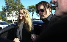 This file photo taken on 17 April, 2016 shows US actor Johnny Depp and his wife Amber Heard as they arrive at a court in the Gold Coast. Picture: AFP.