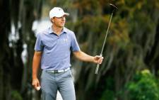 Jordan Spieth waves to the gallery on the 18th green after his 10-stroke victory at the Hero World Challenge on 7 December 2014. Picture: AFP.