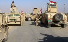 FILE: Iraqi security forces gather in the Rawa area during an operation to retake the Euphrates Valley town from the Islamic State group. Picture: AFP
