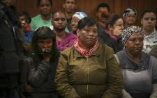 FILE: The mother of three-year-old Courtney Pieters (left) sits in Goodwood Magistrates Court where her daughter's alleged murderer appeared. Picture: Cindy Archillies/EWN