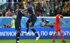 France's midfielder Paul Pogba and France's midfielder Corentin Tolisso celebrate the team's victory in the Russia 2018 World Cup semi-final football match between France and Belgium at the Saint Petersburg Stadium in Saint Petersburg on 10 July 2018. Picture: AFP