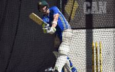 Australia's captain Steve Smith plays a shot during a net practice session at Gabba in Brisbane on December 14, 2016, on the eve of a day-night Test cricket match against Pakistan. Picture: AFP