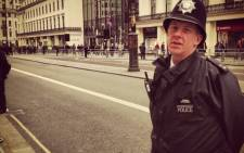 A policeman stands ready on the streets of London on the day of Margaret Thatcher's funeral, 17 April 2013. Picture: Mandy Southgate/iWitness