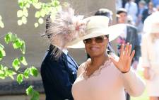 US presenter Oprah Winfrey arrives for the wedding ceremony of Britain's Prince Harry, Duke of Sussex and US actress Meghan Markle at St George's Chapel, Windsor Castle, in Windsor, on 19 May 2018. Picture: AFP