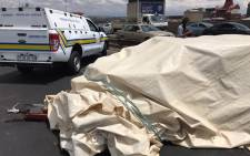 A trailer carrying over two dozen dead bodies is seen on the M1 in Braamfontein after an accident. Picture: Christa Eybers/EWN.