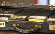 A case of cassette tapes that belonged to Britain's Diana, Princess of Wales, containing albums by singers Diana Ross, Elton John and George Michael, is pictured at Buckingham Palace in London on 20 July 2017. Picture: AFP