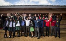 Gauteng's top achieving matric pupils throw their hands in the air after their awards ceremony in Daveyton on 5 January 2017. Picture: Reinart Toerien/EWN