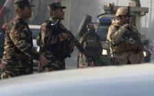 FILE: Afghan security personnel block a road near the site of a suicide attack in Kabul. Picture: AFP