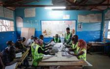 Polling station officials count the ballots at a polling station in Archers Post, Samburu County, in Kenya on 8 August 2017. Picture: AFP