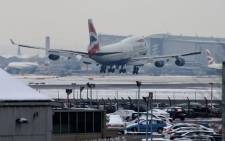 A plane lands at Heathrow airport in west London on 21 January 2013 after the airport announced further flight cancellations due to adverse weather. Picture: AFP.