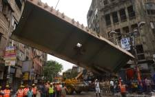 Indian rescue workers try to free people trapped under the wreckage of a collapsed flyover bridge in Kolkata on 1 April, 2016. Picture: AFP.
