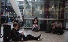 Travellers stranded wait at Heathrow Airport Terminal 5 after British Airways flights where cancelled at Heathrow Airport in west London on 27 May 2017. Picture: AFP