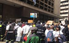 Emergency services workers outside Gauteng Premier David Makhura's office in the Johannesburg CBD on 28 August 2017. Picture: Masego Rahlaga/EWN