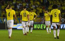 Colombian players react after losing to Paraguay their 2018 World Cup football qualifier match in Barranquilla, Colombia, on 5 October, 2017. Picture: AFP.