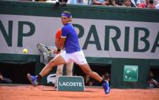 Rafael Nadal in action during his French Open quarterfinals match against fellow Spaniard Pablo Carreno Busta. Picture: Twitter/@rolandgarros.
