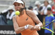 Britain's Johanna Konta returns the ball to Jelena Ostapenko of Latvia during Rome's WTA Tennis Open tournament at the Foro Italico, on 16 May 2018 in Rome. Picture: AFP.