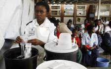 FILE: A nurse at the Budiriro Polyclinic prepares a sugar solution for patients in Harare. Picture: AFP
