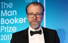 US author George Saunders holds his book and the award for the 2017 Man Booker Prize for Fiction, at the Guildhall in central London on 17 October 2017. Picture: AFP