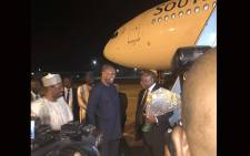 President Cyril Ramaphosa is welcomed by Nigerian Foreign Minister Geoffrey Onyeama. Picture: Qaanitah Hunter/EWN