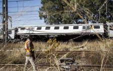 A PRASA (Passenger Rail Agency of South Africa) official stands next to the wreckage of two trains which collided near the Elandsfontein station in Johannesburg on Thursday morning leaving one person dead and over 100 injured. Picture: Reinart Toerien/EWN