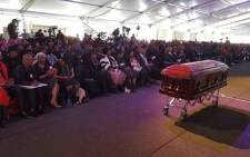 Ray Phiri's casket sits in front of widow Rabelani Phiri, and family at Special Provincial Official Funeral Mbombela Stadium. Picture: Louis McAuliffe/EWN