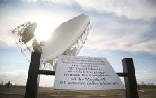 One of the 64 radio telescopes that are part of the MeerKAT project behind a plaque unveiled by Deputy President David Mabuza. Picture: Bertram Malgas/EWN