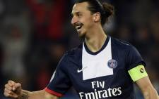 Paris' Swedish forward Zlatan Ibrahimovic celebrates scoring a goal during the French L1 football match Paris Saint-Germain (PSG) vs Montpellier (MHSC) on May 17, 2014 at the Parc des Princes stadium in Paris. Picture: AFP.