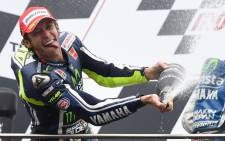 MotoGP rider Valentino Rossi of Italy celebrates winning the Australian MotoGP Grand Prix at Phillip Island on October 19, 2014. Picture: AFP