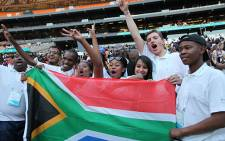 Youngsters celebrate during the opening ceremony of the One Young World Summit 2013 at the FNB Stadium. Picture: Vumani Mkhize/EWN