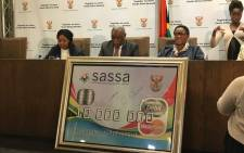 Sassa CEO Pearl Bhengu (left), Telecommunications and Postal Services Minister Siyabonga Cwele and Social Development Minister Bathabile Dlamini at a media briefing. Picture: EWN
