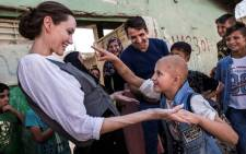 This handout picture released by the UNHCR, shows Special Envoy Angelina Jolie meeting Falak, 8, during a visit to West Mosul, on June 16, 2018. Picture: AFP.