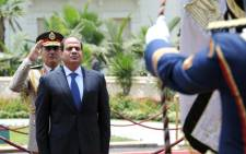 Egypts President Abdel Fattah al-Sisi reviewing the honour guard during the handing over of power ceremony in Cairo on 8 June 2014. Picture: AFP.