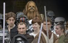 FILE: People wearing costumes take part in a 'Star Wars' convention in France. Picture: AFP.