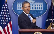 Barack Obama answers questions at a news conference. Picture: AFP.