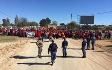 Hundreds of EFF members in Coligny are marching to the local police station against alleged police corruption. Picture: Hitekani Magwedze/EWN.