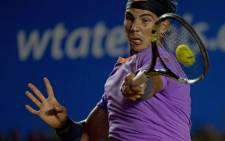 Rafael Nadal of Spain returns the ball to his compatriot David Ferrer. Picture: AFP