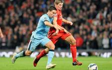 Manchester City's Samir Nasri vies for the ball with Liverpool's Steven Gerrard during an EPL match on 25 August 2014. Picture: Official Manchester City Facebook page.