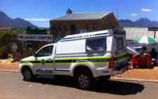 Police are keeping a close eye on this registration station in Kayamandi following a violent protest on 8 February 2014. Picture: Siyabonga Sesant/EWN.