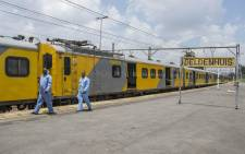 Officials and rescue services personnel on the scene of a train crash in Germiston on 9 January, 2018. Picture: Ihsaan Haffejee/EWN
