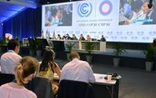 FILE: Members of representative commissions of the countries participating in the UN Climate Change Conference on 13 December, 2014 in Lima. Picture: AFP.